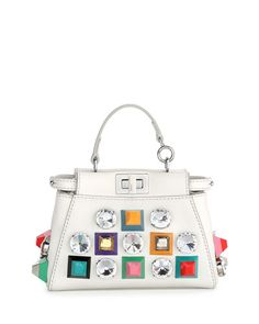 """Fendi """"Peekaboo"""" micro leather satchel bag with multicolor plastic studs and clear crystals. Top handle with rings. Detachable shoulder strap. Framed top with double-sided turn-lock closures. Button t"""