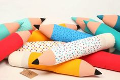 cojin-lapiz...contemporary modern decor style plushie pencil bolster pillows such a cool idea for a kitsch but slick living room or art space or cool imagination play toy for kids to pretend to write on the walls with