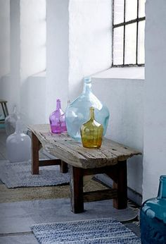Different coloured and shaped large bottles and jugs add to Meditteranean decor.      ᘡղbᘠ