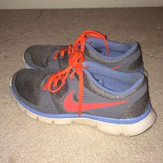 Nike Flex Experience RN Nike Flex Experience RN. Lightly used. Size 8.5. Dark grey and blue colors with neon orange laces and nike swoosh and white bottoms. Nike Shoes Athletic Shoes