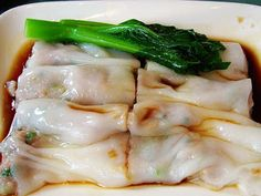CHEONG FUN (RICE NOODLE ROLLS) WITH SHRIMP==INGREDIENTS== MAKES 8 TO 10 RICE NOODLE ROLLS= NOTE: YOU Can SUBSTITUTE THE PRAWNS W/ DICED CHINESE BBQ PORK OR MARINATED GROUND BEEF. 150 g rice flour, 3T wheat starch, 2T tapioca starch, 1T vegetable oil, 200 ml cold water, 300 ml hot (boiling) water, 1/2t salt, 20 to 30 prawns/large shrimp, sweet soy sauce (Chinese rock sugar and soy sauce to taste, heated until the sugar has dissolved and then cooled completely) ============