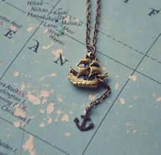 sailing ship and anchor necklace.