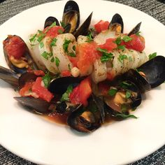 Mussels and calamari in a spicy white wine tomato broth.  #delicious #fresh #healthyfood #flavour @zimmysnook