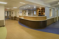 The appealing lines of the nurses' station in the adult intensive unit elegantly conceal staff telephones, video monitors, and other clinically sensitive items. Battleboro Retreat. Courtesy of Joseph St. Pierre at JSPhotography.