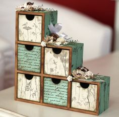 Cute boxes...although the stuff glued on top would make me crazy...love the drawers and patterns, though.