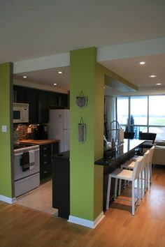 Contemporary - kitchen. I really like the green with dark (black) cupboards.