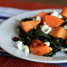 Warm Swiss Chard Salad with Butternut Squash, Pine Nuts, Dried Cranberries, and Goat Cheese