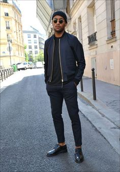Shop this look on Lookastic: http://lookastic.com/men/looks/beanie-and-bomber-jacket-and-crew-neck-t-shirt-and-dress-pants-and-derby-shoes/3989 — Navy Beanie — Navy Bomber Jacket — Black Crew-neck T-shirt — Navy Dress Pants — Black Leather Derby Shoes