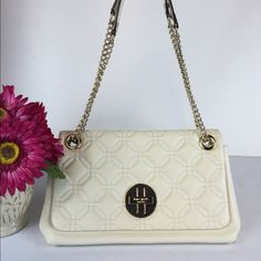 """💐HOST PICK💐Kate Spade Quilted Shoulder/Crossbody This is a gorgeous winter white  Kate spade convertible Crossbody/shoulder bag with light gold hardware. It is in excellent condition and only has a couple of small indentations on the back of the bag from sitting in the dust bag on the chain.  Other than that perfect condition! The interior of the bag has one zippered pocket & 2 slip pockets. This is from a smoke/pet free home. See extra pics! Comes with Original dust bag! 6 """" D x 12"""" L x…"""