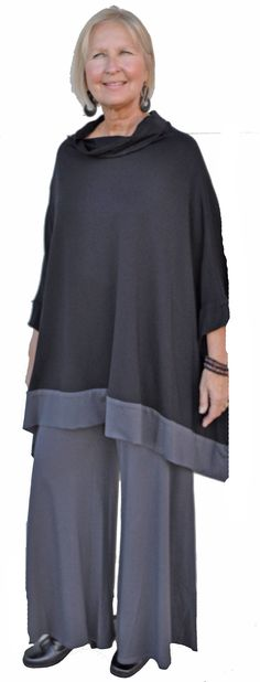 Very dramatic caped tunic top with contrast banding and matching pant.