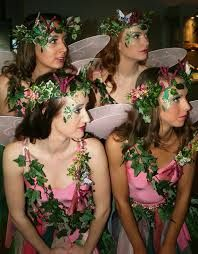 Fairy costumes and make up. All in pink. Tulle skirts. Fake ivy head wreaths. Same ivy over the dresses.