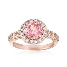 Give something beautiful to that special woman in your life!  Our 2.00 carat pink CZ brings you the luscious blush of more expensive stones. It glistens within a halo of sixteen white CZs of .23 ct. t.w. and .32 ct. t.w. of CZs extend down the band. Polished 14kt rose gold over sterling silver ring #RossSimons