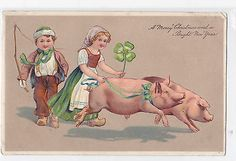 VINTAGE GERMAN EMBOSSED CHRISTMAS POSTCARD DUTCH CHILDREN WITH TWO PIGS