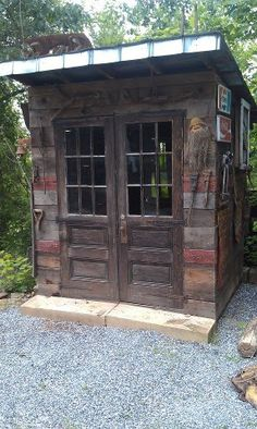 love this idea of using reclaimed wood and doors for a garden shed