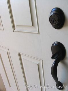 She spray painted all her door knobs with rustoleum oil rubbed bronze. after more than a year, they're apparently still holding up!