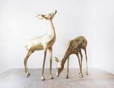 Two amazing large vintage brass deer figurines. One buck and one doe make up this collection, with the buck standing upright displaying his