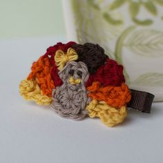 Crocheted Turkey Hair Barrette (Etsy). Could prob trial and error to figure out how to make one like this.
