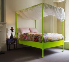 i never would have thought of a neon chartreuse four poster bed, but this is fantastic.