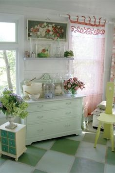 flea market style.....loving all that is going on in this room...neat curtain, floor.....