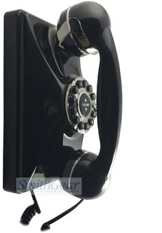 The 1930 Retro Wall Phone in BLACK adds a classic style and look to almost any decor. This sturdy wall telephone is built with commercial grade construction and has the feel, look and size of the original 1930's phone.  The phone features excellent sound quality (with 8 levels of volume control) and a genuine bell sounding ringer. While it looks like a rotary dial it actually has convenient touchtone push buttons for easy dialing.