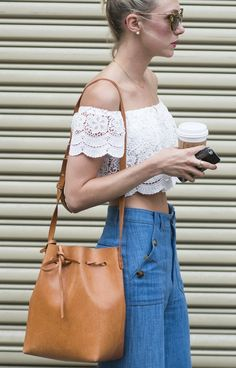 Lace crop top, high-waisted jeans, and a Mansur Gavriel bucket bag