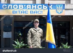 Sloviansk, Ukraine - July 5, 2016: Unidentified Soldier Stands Near A Ukrainian Flag In Sloviansk At Ceremonial Meeting In Honor Of Second Anniversary Of Sloviansk Liberation From Russian Fighters Stock Photo 448121551 : Shutterstock