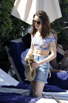 Quirky: Not letting her famously trendy style falter in swimwear, the beauty revealed a retro high-waisted bikini underneath, adorned with a bold print of spots and stripes Retro High Waisted Bikini, Toned Abs, Pink Bikini, Lily Collins, Trendy Fashion, Trendy Style, Pastel Pink, Supermodels, Bikinis