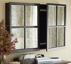 mirrored cabinet to hide TV. Super cool idea!