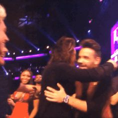 The boys celebrating with a group hug after winning the AMA Artist of the Year award - 11/22/15