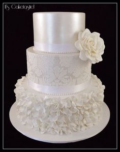 Here's my new favourite wedding cake! The top two tiers were painted with pearl lustre. The damask pattern on the second tier was done ...
