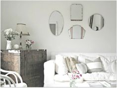 A bunch of smaller mirrors instead of one large one. Idea for side table.