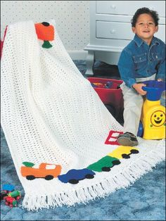 "Choo-Choo Train Afghan - Boys and girls alike will love this playful, kid-sized afghan.Size: 39"" x 66"".  Skill Level: Beginner  free pdf from freepatterns.com"