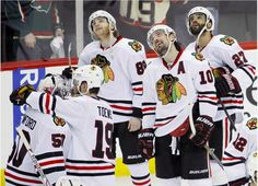 Patrick Kane, Patrick Sharp, Johnny Oduya watch the replay of Kane's GWG; Jonathan Toews greets Corey Crawford after the Blackhawks beat the Wild in OT of Game 6 on May 2014 Hockey Baby, Hockey Girls, Ice Hockey, Kings Hockey, Boys, Field Hockey, Flyers Hockey, Hockey Teams, Hockey Players