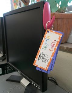 Laminated log-in cards on a hook beside the computer monitor.  Need to make these for all the different sites the kiddos can use!