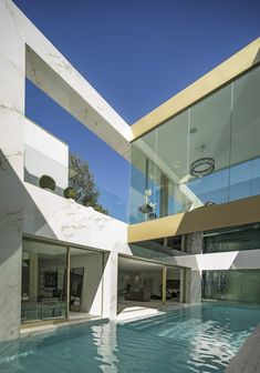 """The """"Opus"""" property features a basement-level pool, billiards room, champagne room, wine room, and a movie theater."""