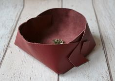 A personal favourite from my Etsy shop https://www.etsy.com/uk/listing/399240267/blush-red-leather-valet-tray-rustic