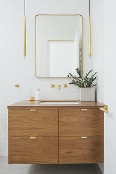 Before & After: A Dark Midcentury Turns Into a Luminous Gem #dwell #modernhome #bathroomdesignideas #pendantlighting #modernbathroom #homerenovation