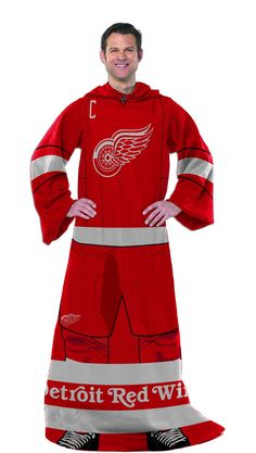 "This OFFICIAL NHL """"Uniform"""" Comfy Throw makes you feel like you are apart of your favorite NHL team! Made of soft, thick luxurious fleece with oversized loose fitting sleeves, The """"Uniform"""" Comfy"