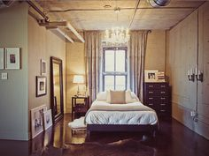 love this bedroom. Again, its a bit masculine but mixed with feminine details. Love it.