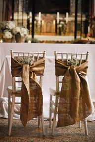 Bride and groom chairs with simple hessian (burlap) tie.  Perfect for outdoor/marquee wedding.