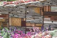 Housing for the tiny winged  creatures. I love this! Functional garden art!