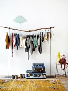 The ABSOLUTE cutest exposed closet. Stacked suitcases for storage. Line up shoes. Hang necklaces/jewellery on the wall.