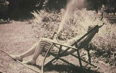 Eudora Welty watering from lawnchair, undated (Photo: © Eudora Welty LLC.)