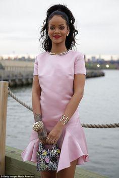 Rihanna before the Paris Dior fashion show looking very chic & girlie in a gorgeous bubblegum pink Dior dress & bag...x