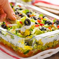 Greek Salad Layered Dip. Literally sounds amazing! #cleaneats