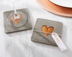 With a concrete and copper look on top, and cork protecting the table from the bottom, a copper heart concrete coaster makes a beautiful addition to any industrial theme wedding!