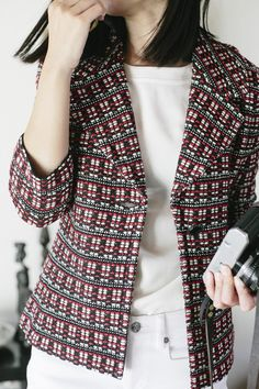 St. John Knits red and neutral colored tweed jacket adds some holiday cheer to this classic office jacket.