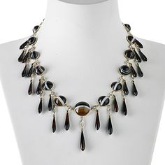 incredible, show-stopping fringe necklace is set with banded agates and diamonds