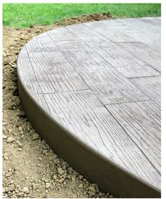Wood panel stamped concrete patio. I'm still leaning towards laying brink pavers, but this would be an awesome alternative.