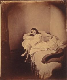International Center of Photography -Julia Arnold, Seated on Unmade bed, ca. 1872. Photography by Lewis Carrol